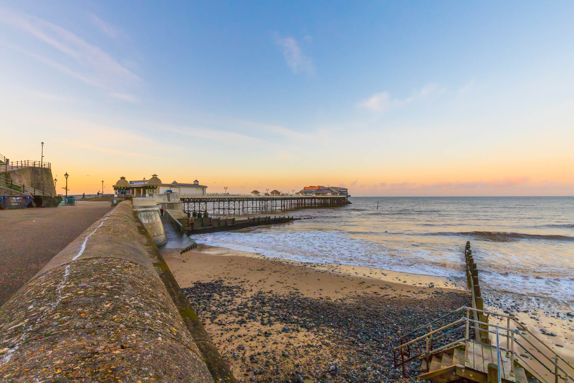 Cromer pier and seaside with a beautiful sunset.