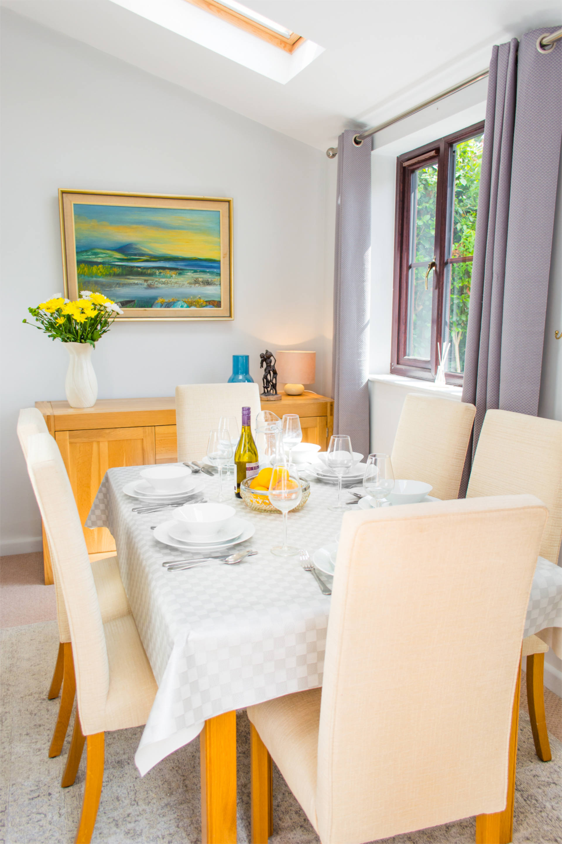 Laid dining table with enough seating for 6 guests.