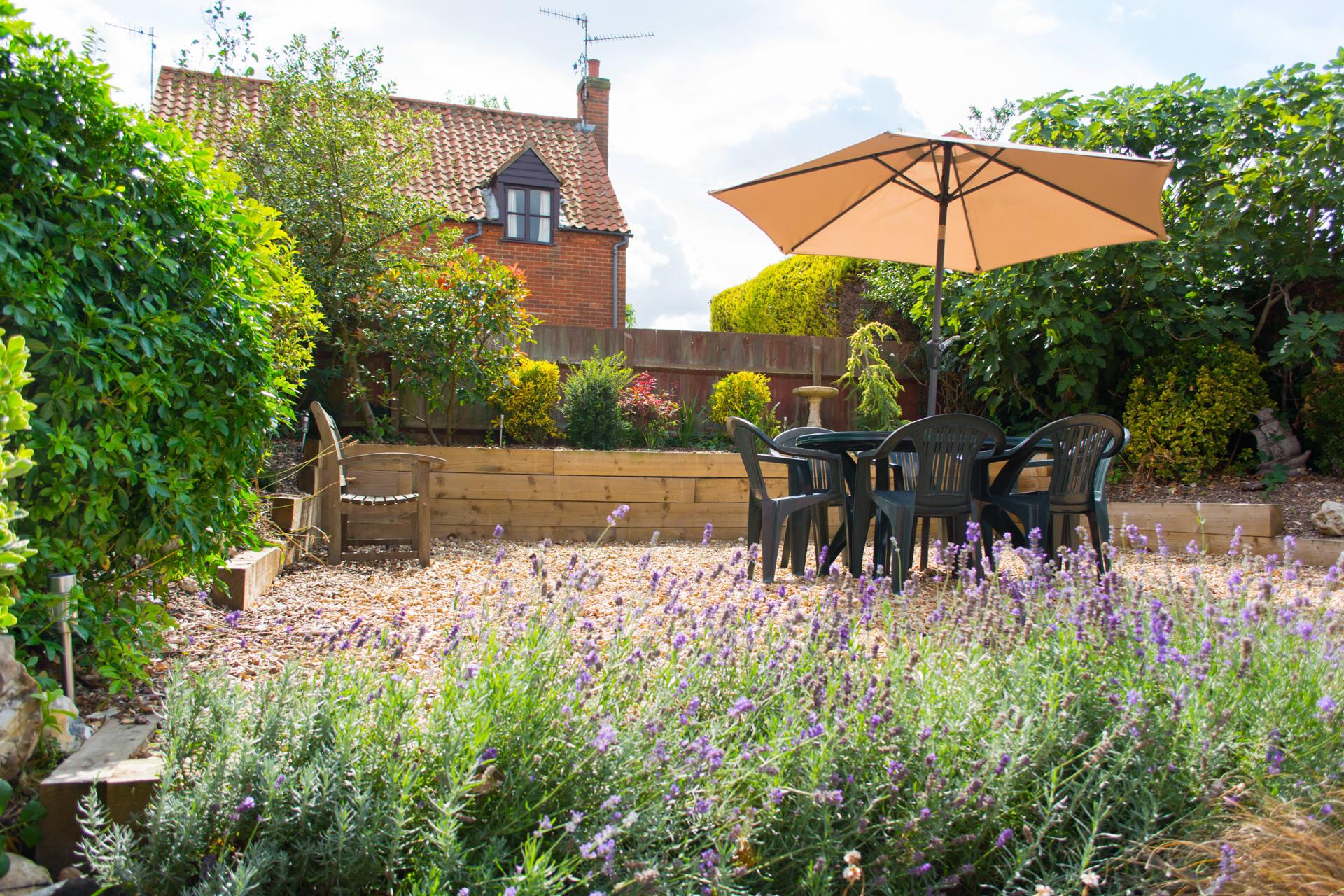 Shingled garden and raised dining area.