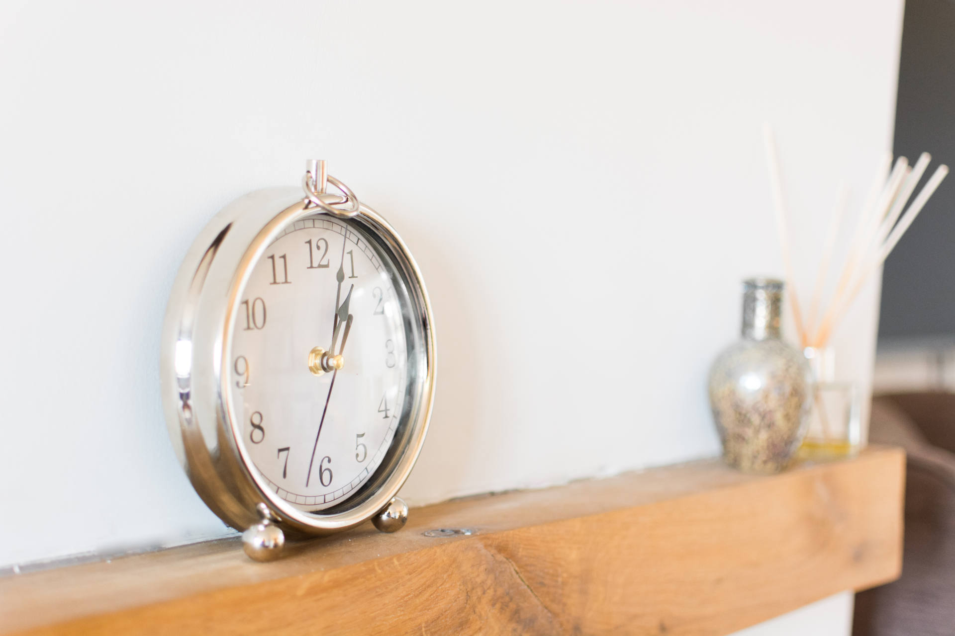 Close up of small ornamental clock.