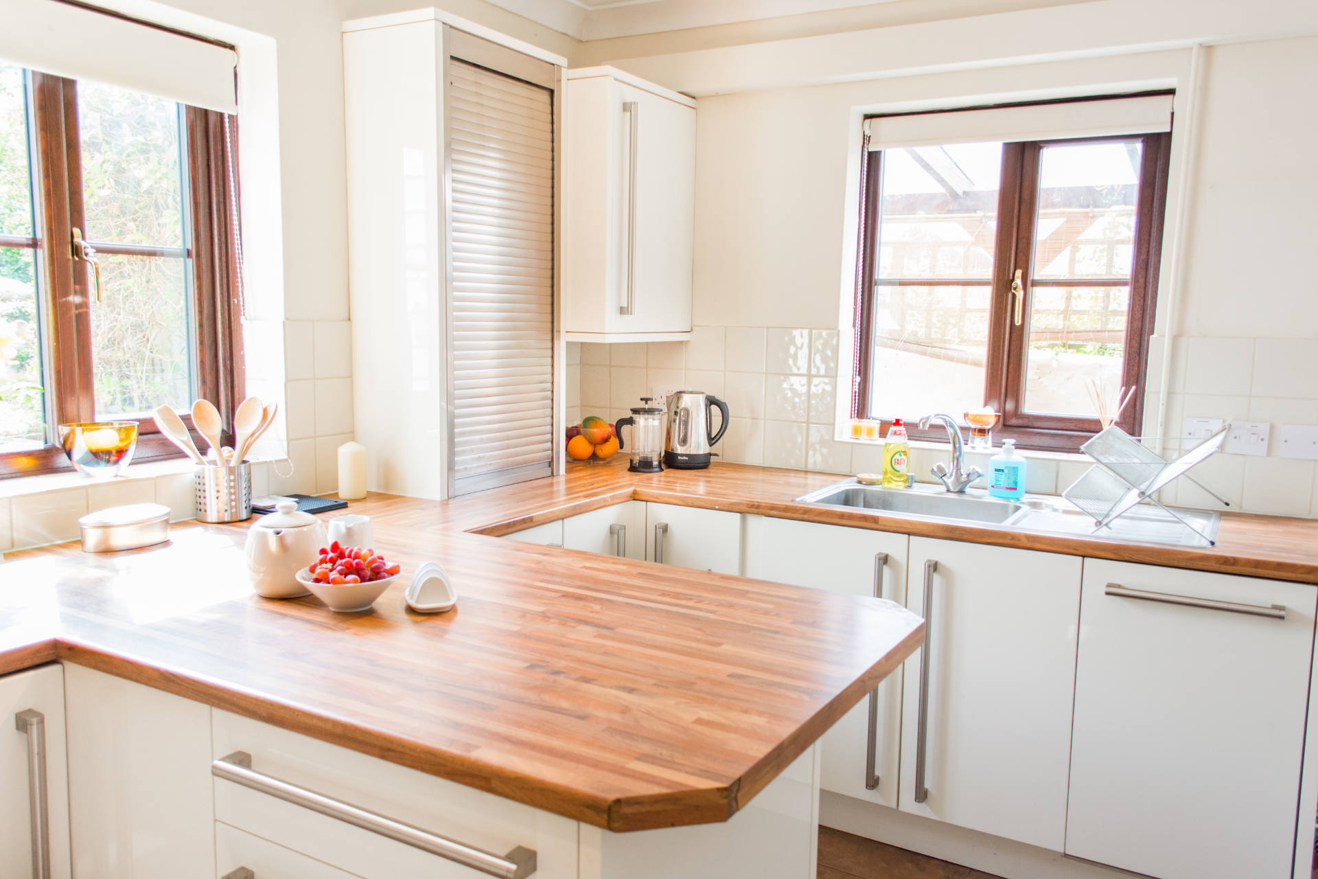 Breakfast bar and worktops with window showing out to the garden.