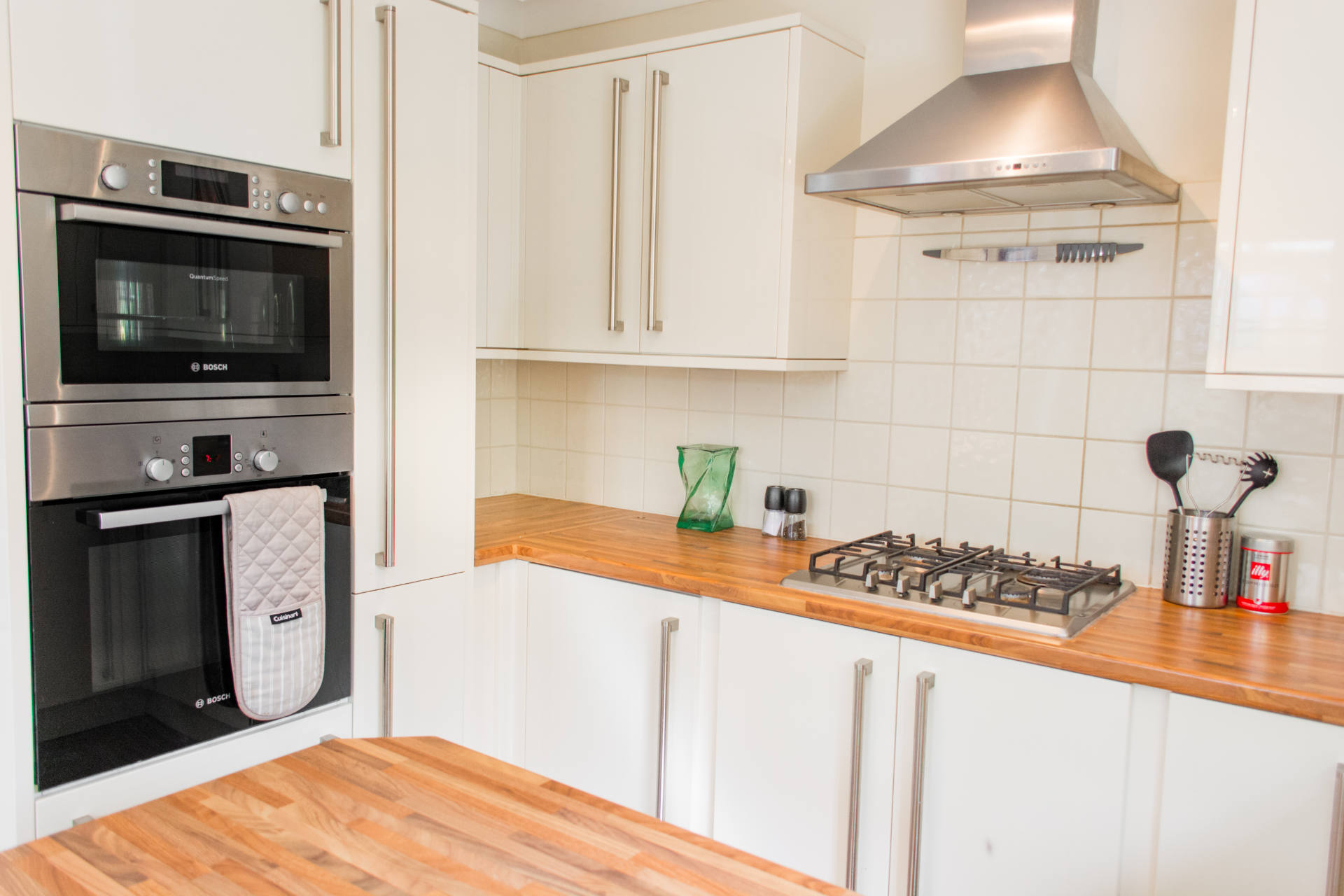 Kitchen oven, hobs and extractor fan.