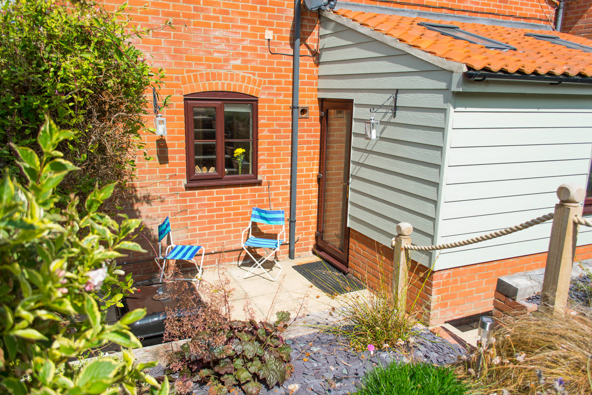 Outside area showing the rear entrance to the holiday cottage.