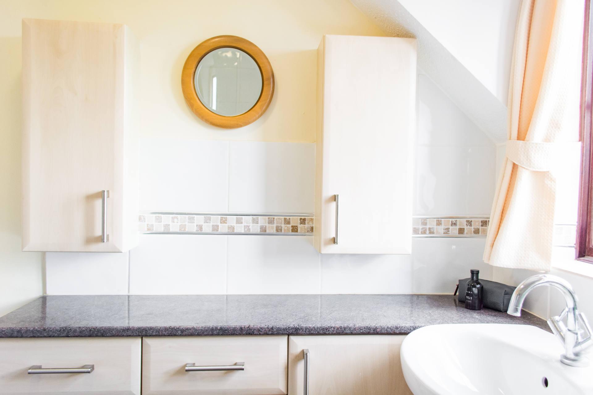 Bathroom mirror and cupboards.