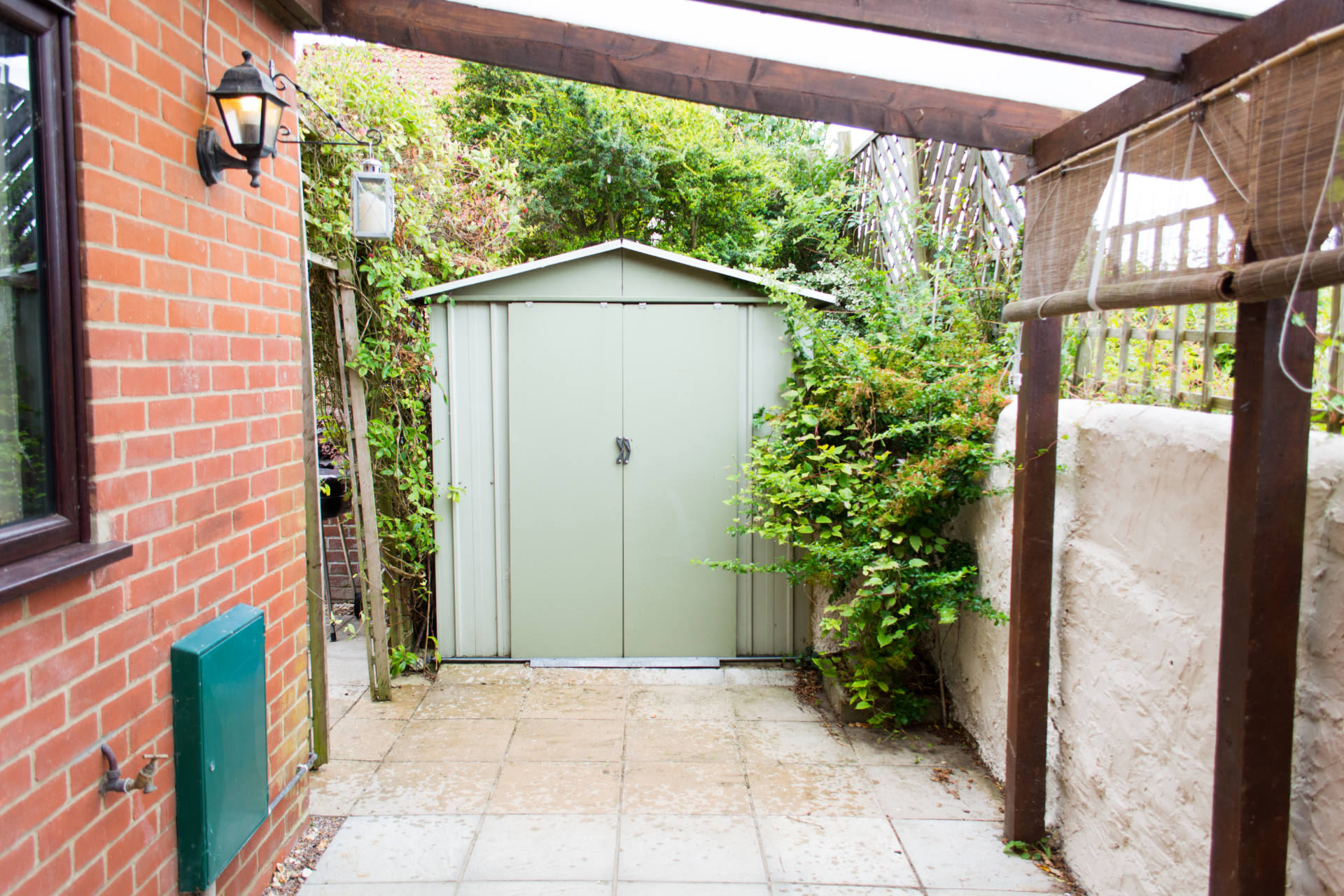Holiday home outside metal storage shed.