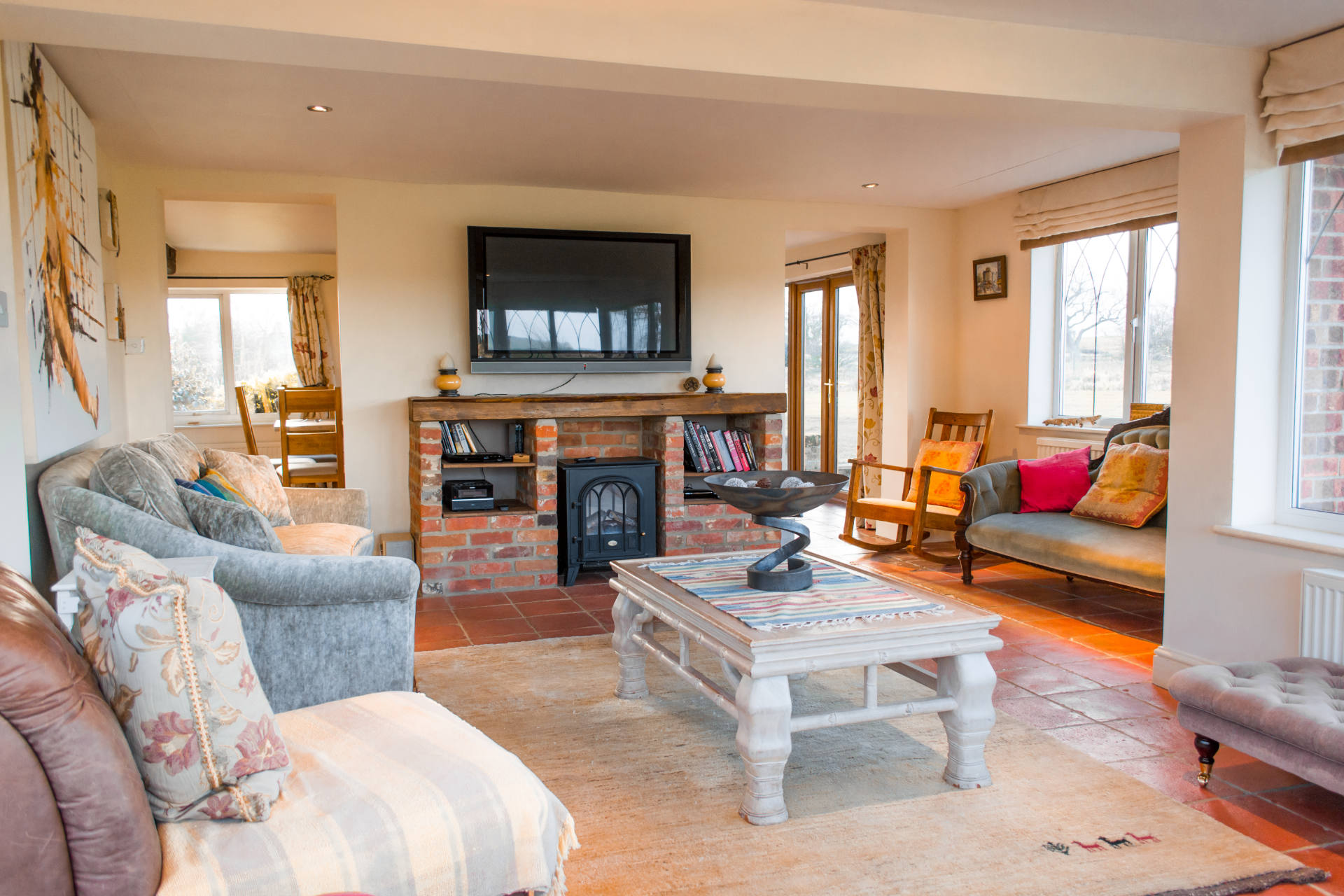 Manor Lodge living and TV room with comfortable seating.