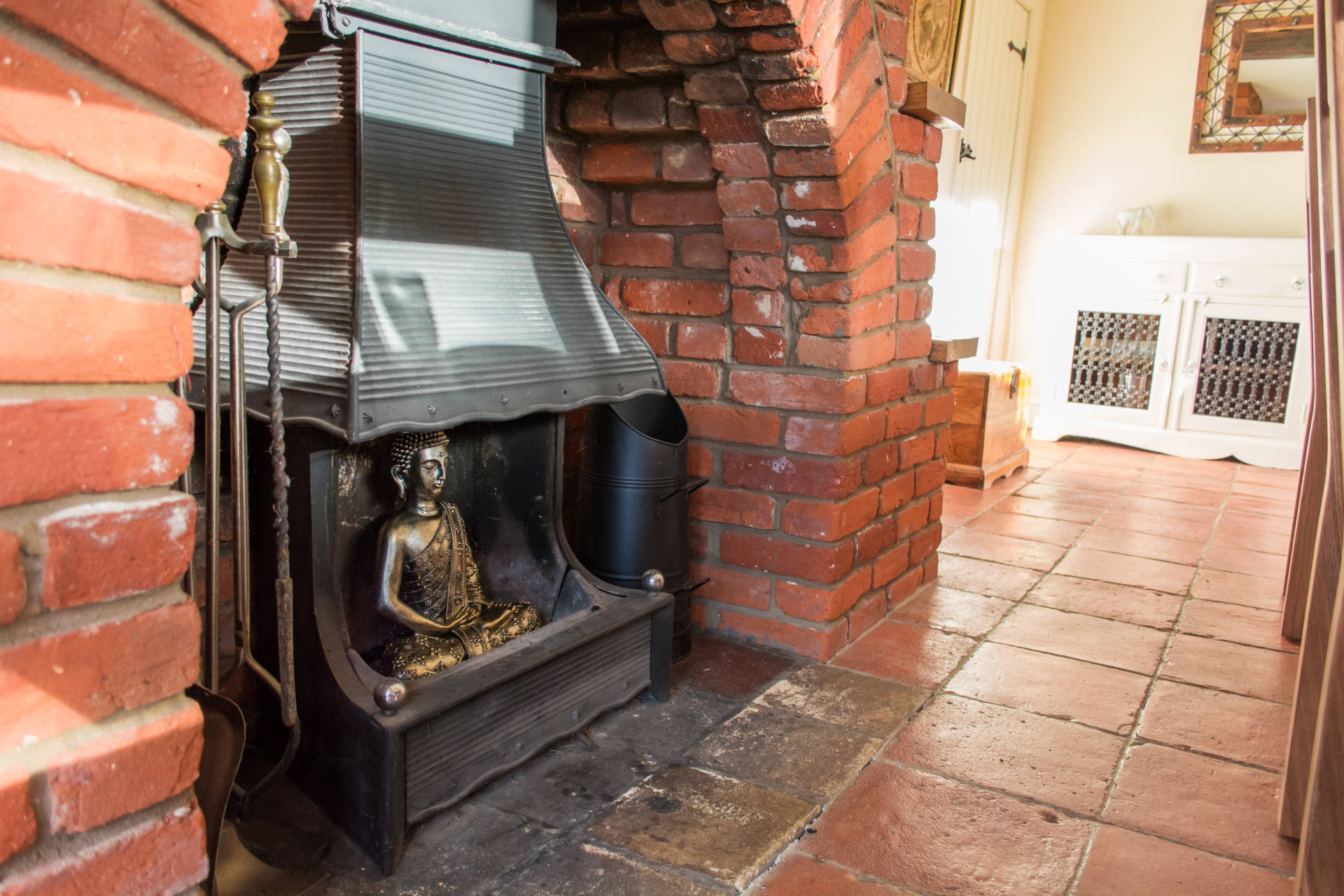 Bricked fireplaces and log burner.