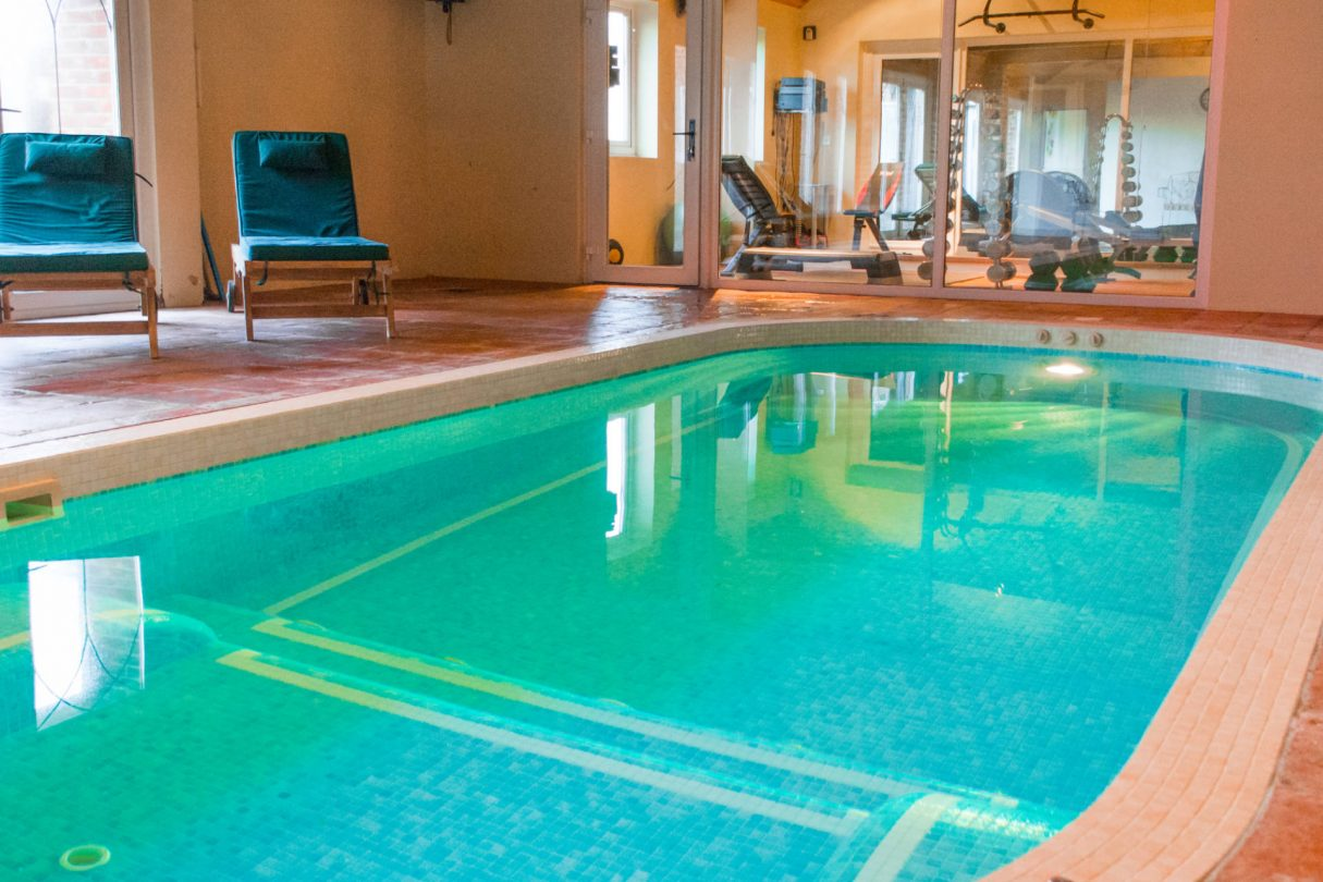 photo showing indoor pool attached to luxury property manor lodge