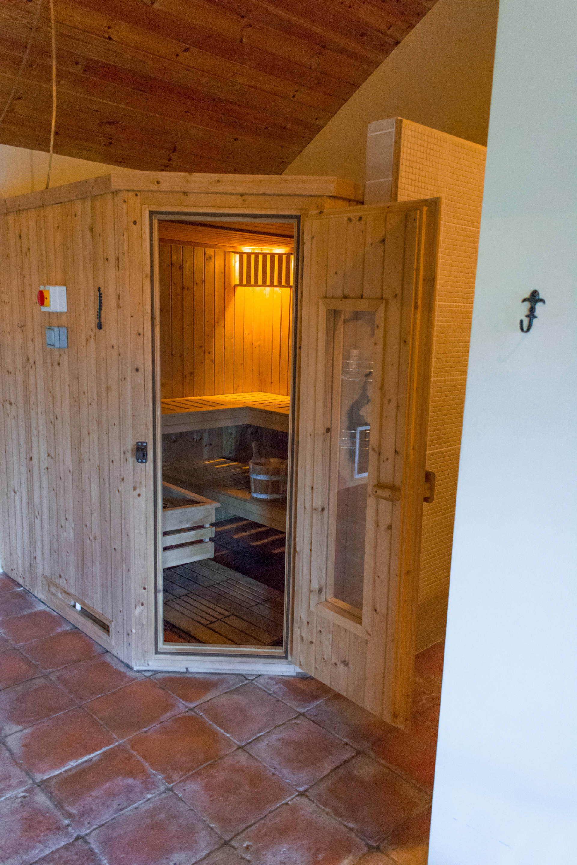 Private sauna with seating.