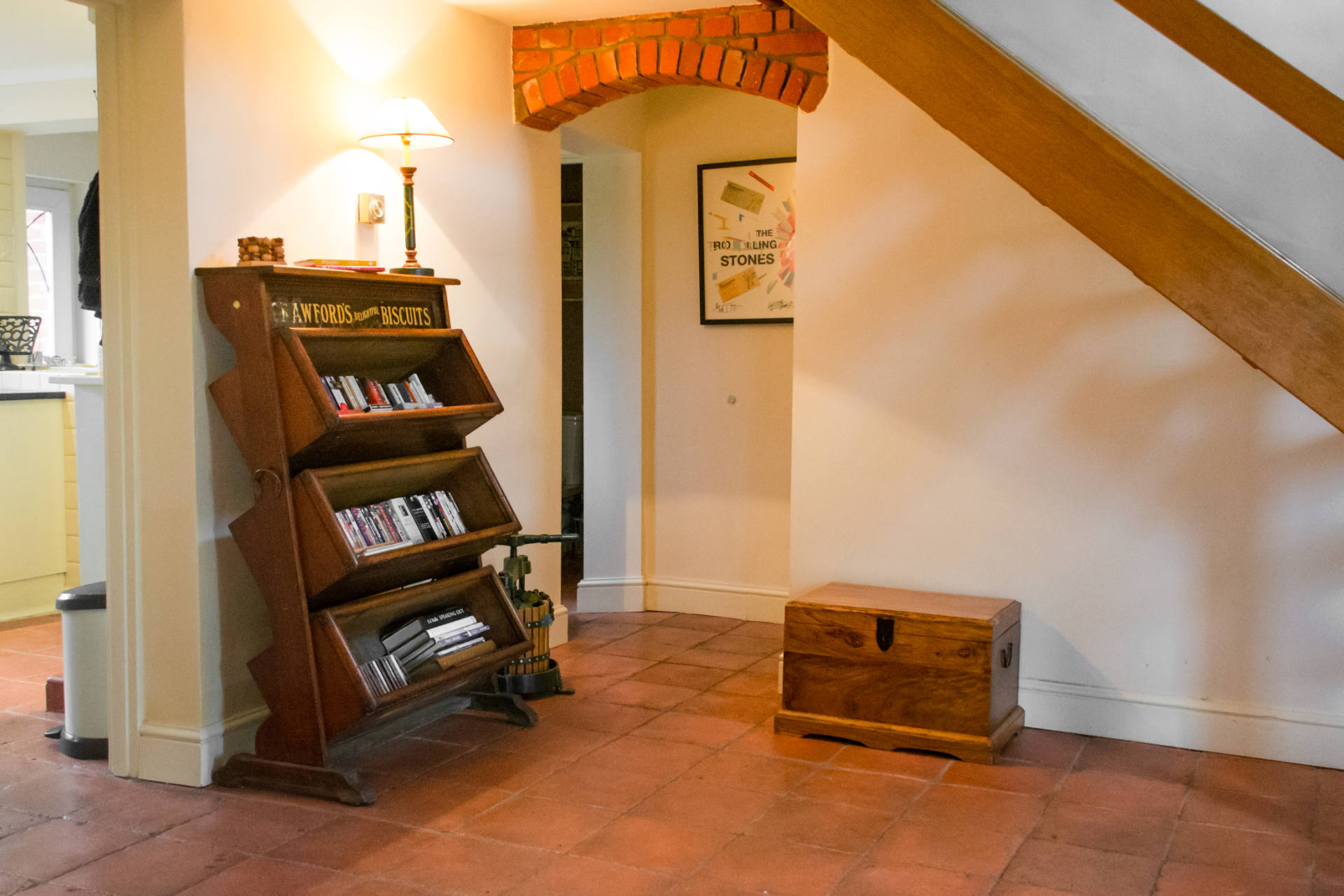Bookcase under the stairs of Manor Lodge entrance.