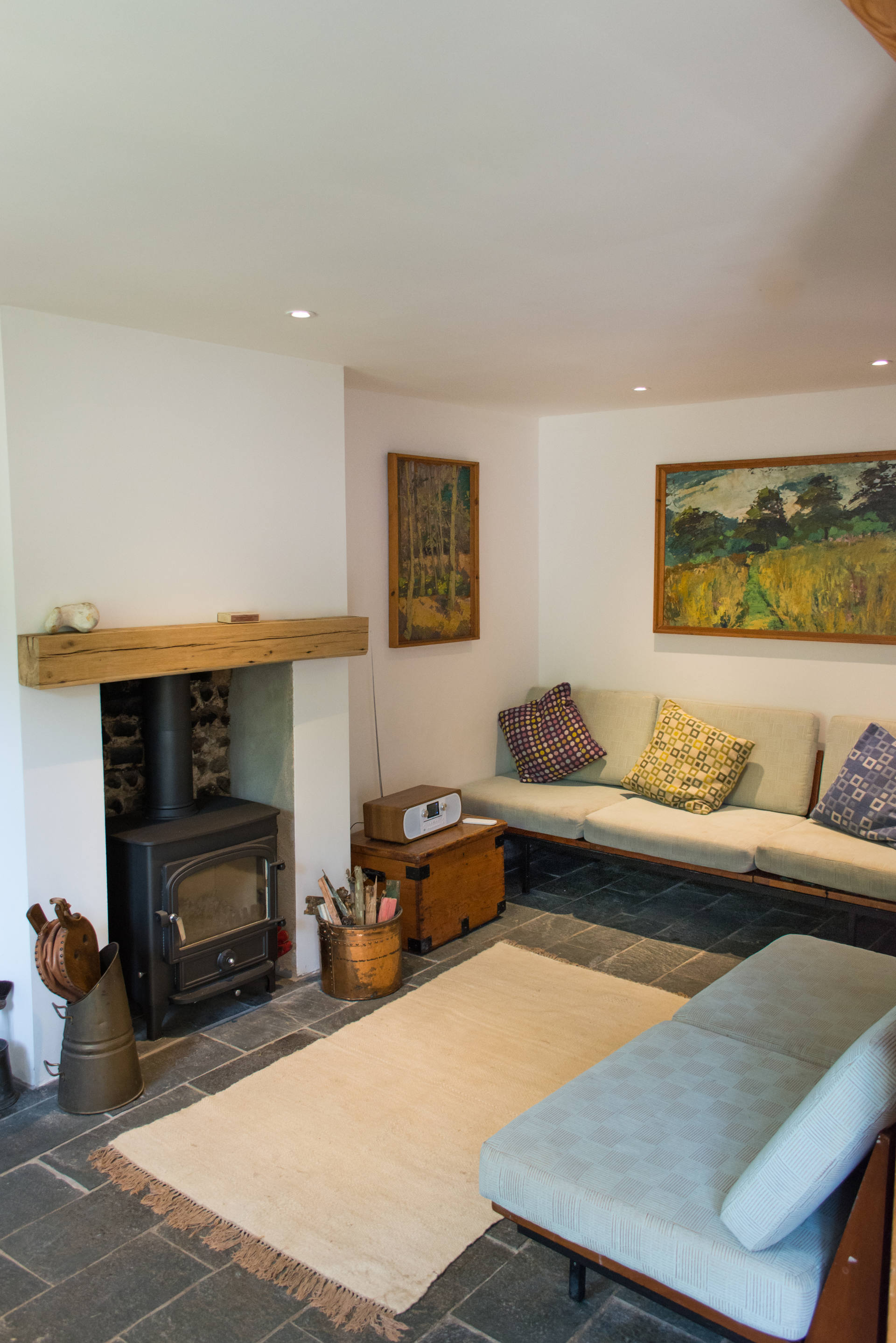 Marlpit Cottage sofas and seating areas with log burner fireplace.