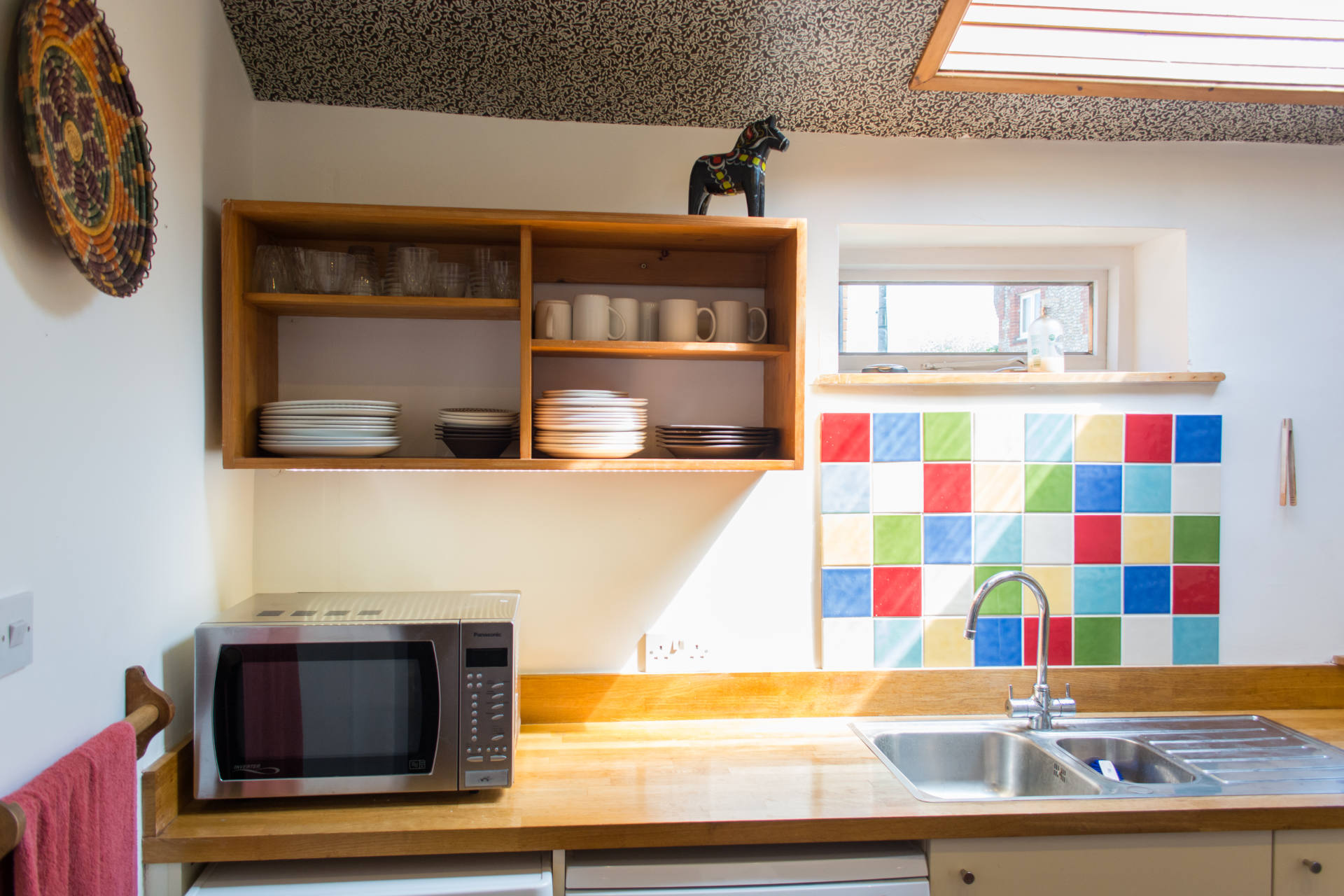 Salthouse holiday home kitchen and microwave.