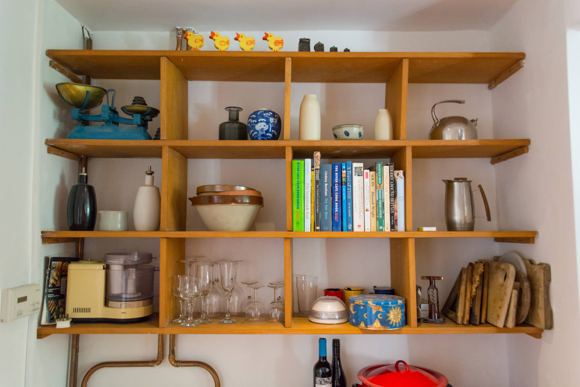 storage shelving for ornaments and cook books.