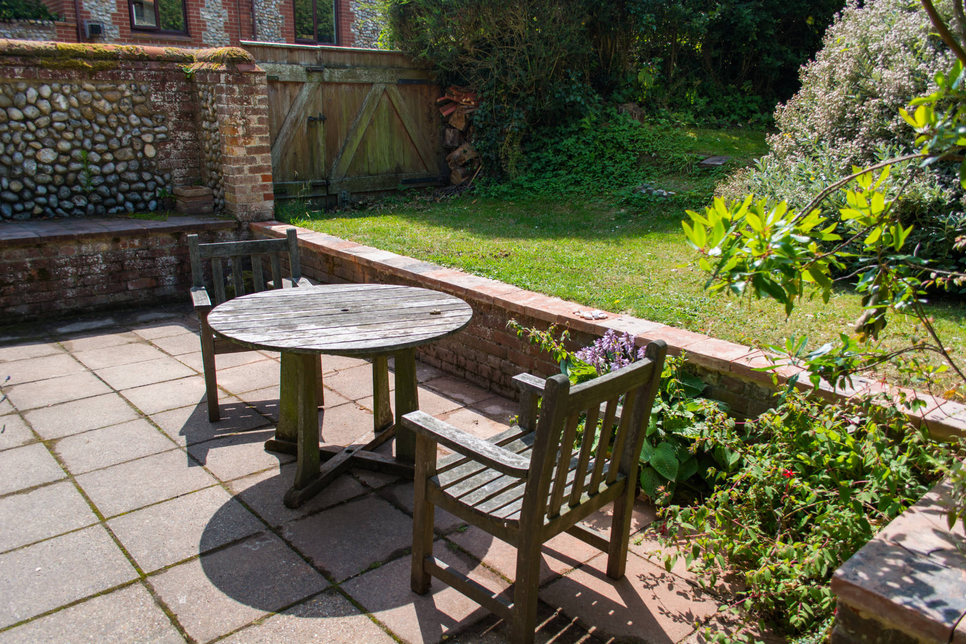 Holiday cottage outside seating area and garden.