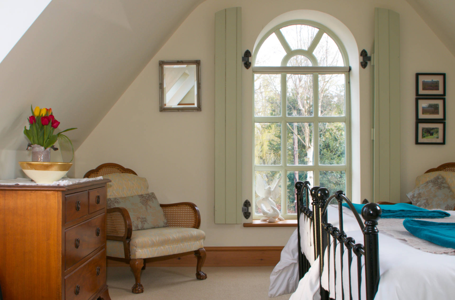 Molly's Den bedroom with large window.