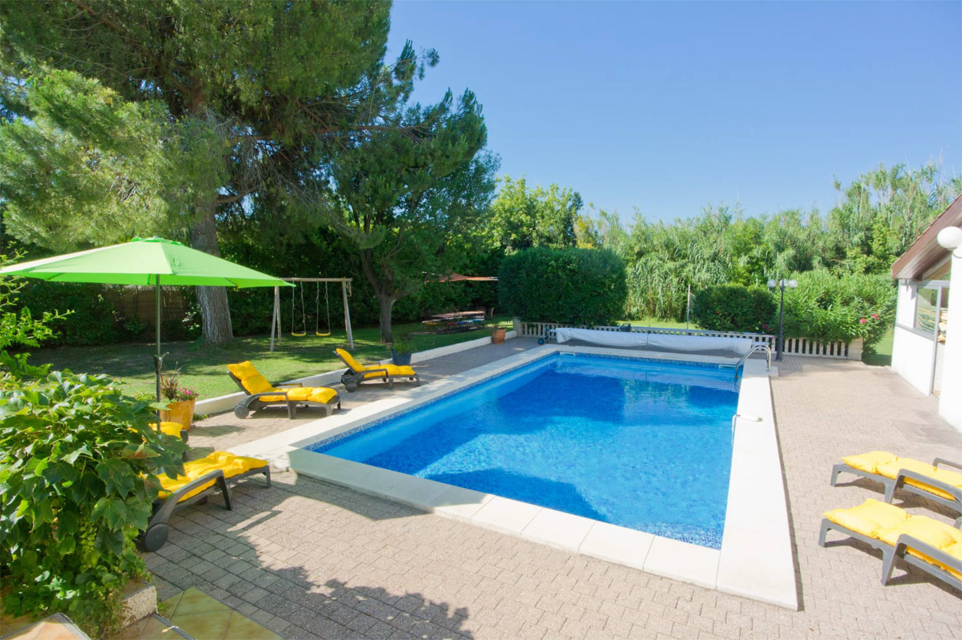 Les Ecureuils holiday home offering an outdoor heated swimming pool.