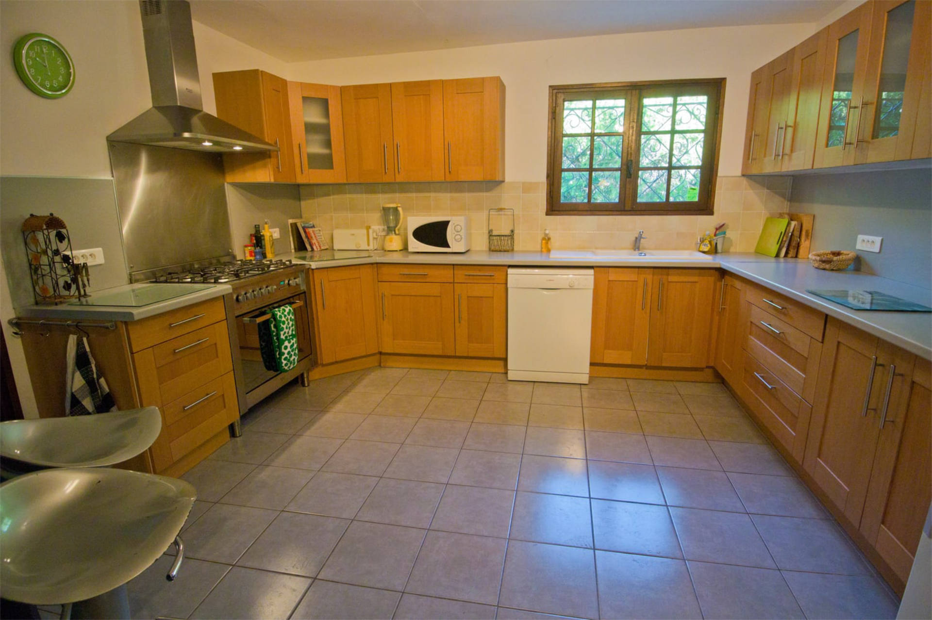 Modern kitchen with dishwasher and other amenities.