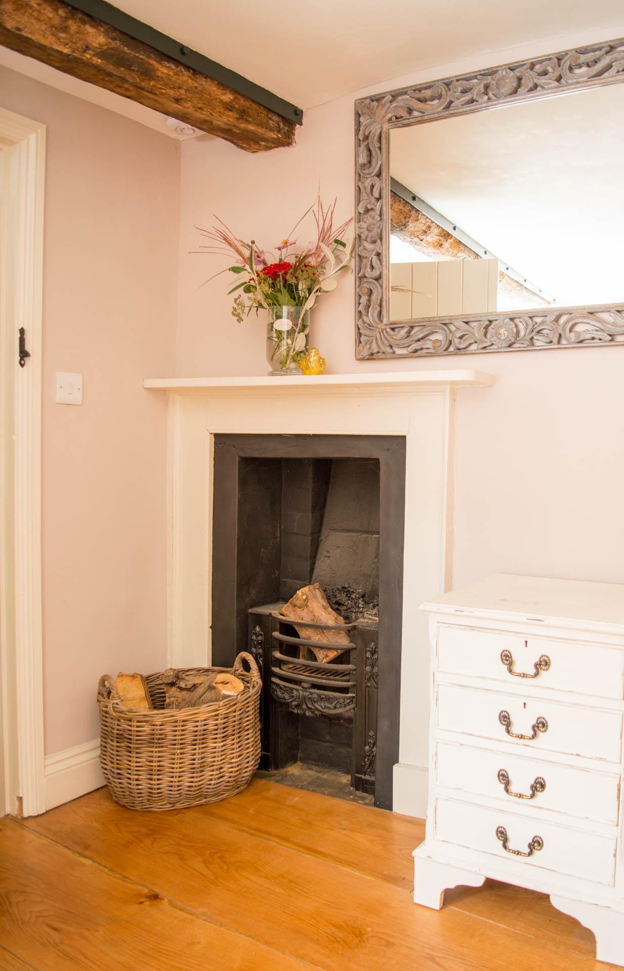 Fireplace and log burner.