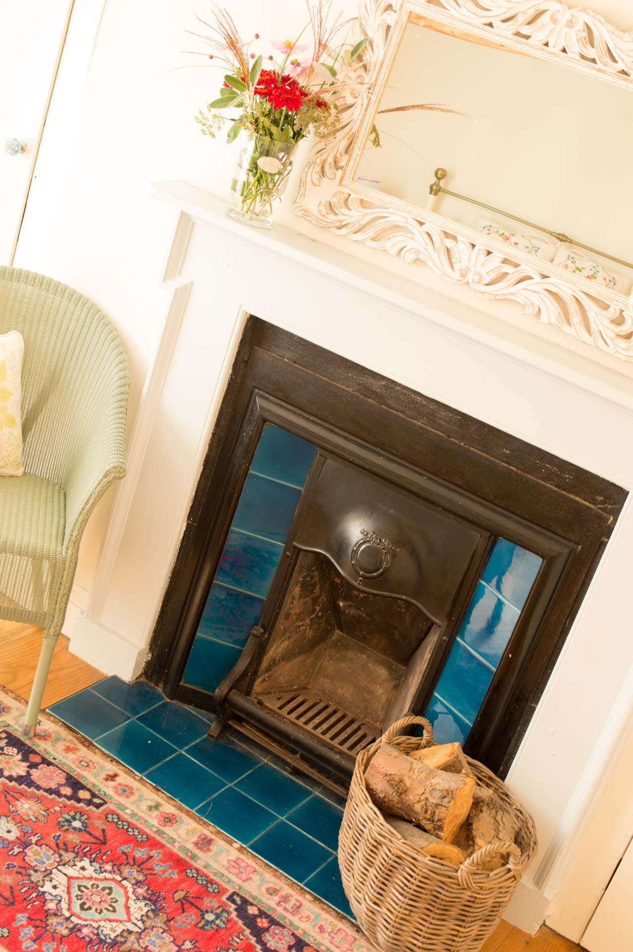Blue and black fireplace and log burner.