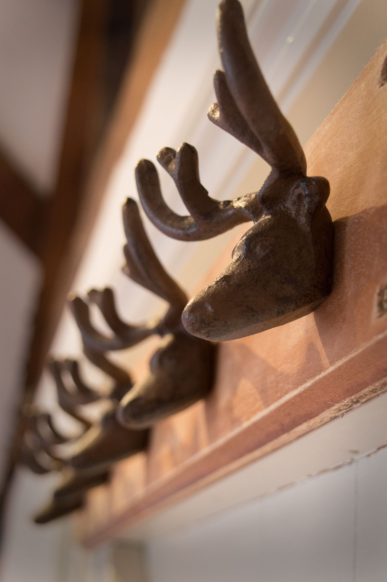 Wooden reindeer coat pegs.