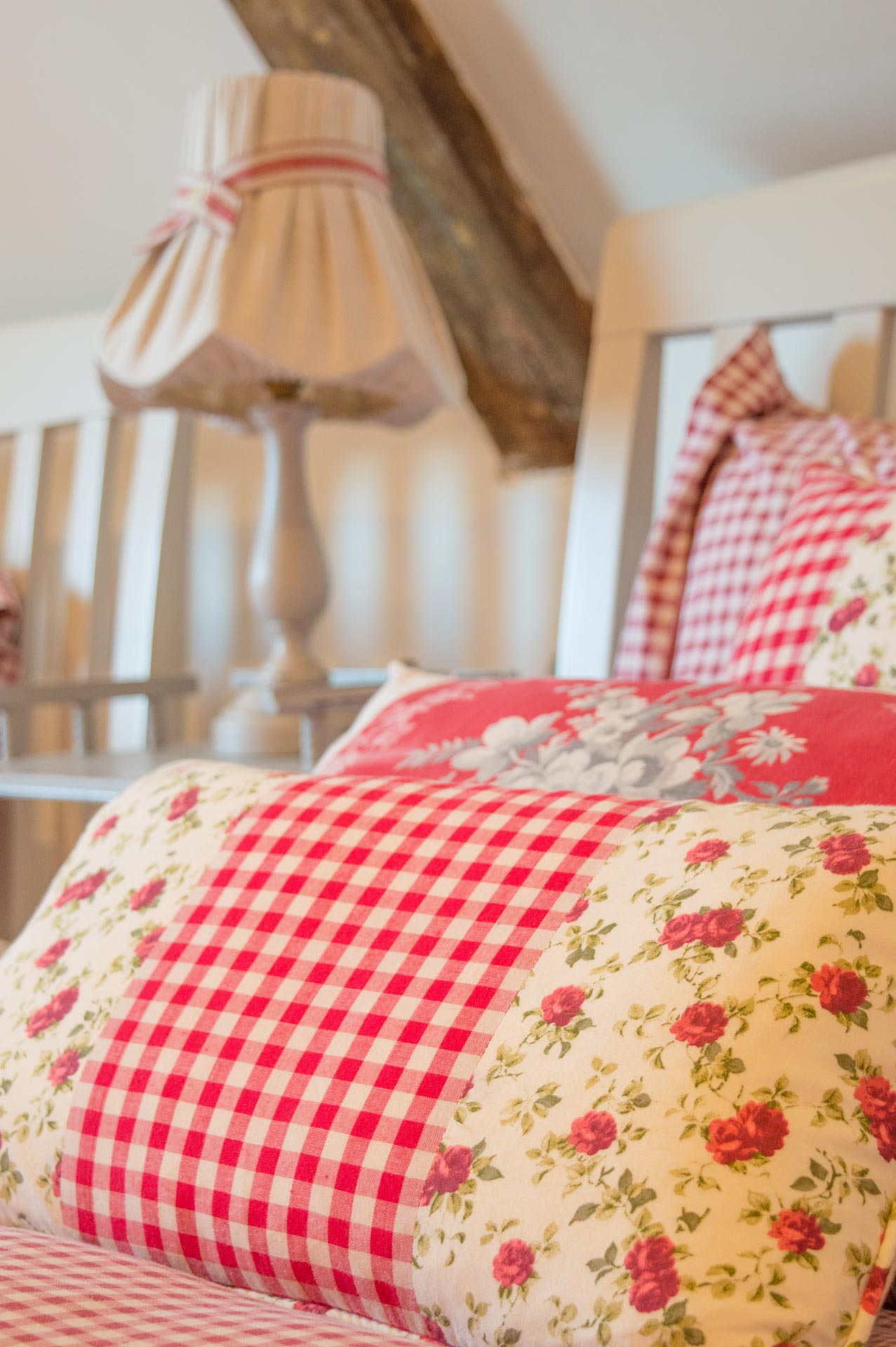 Pink and flowery bedroom pillows.