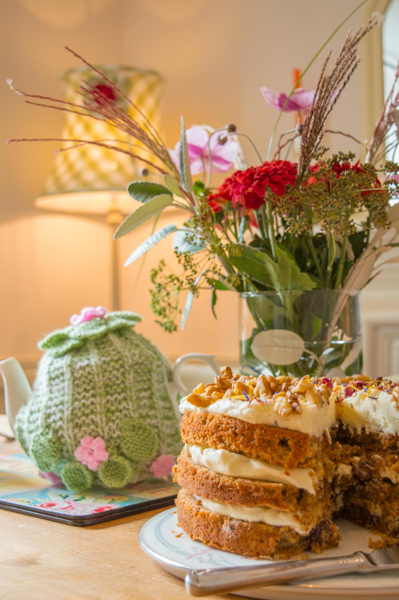Dining table with cake and tea pot.