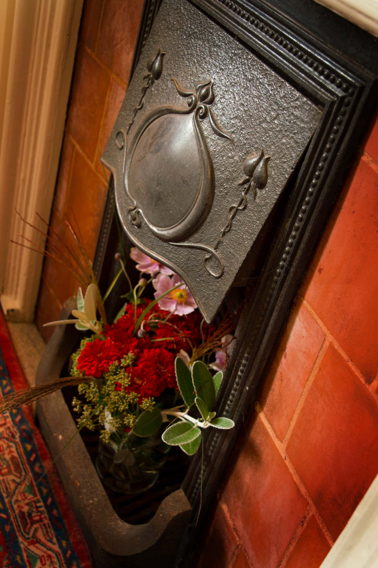 Ornamental fire place with flowers.