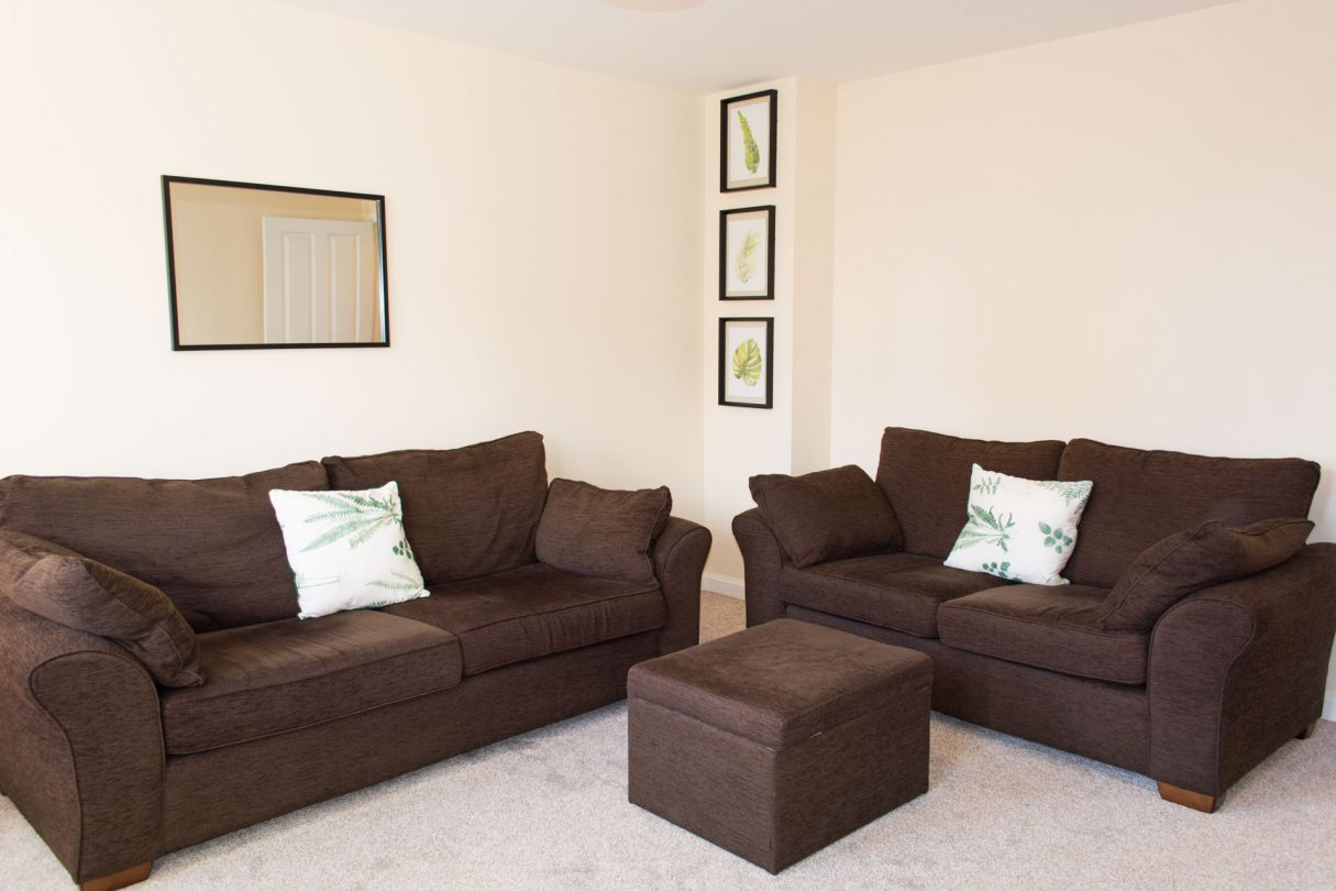 Spacious family living room with large comfortable sofas.