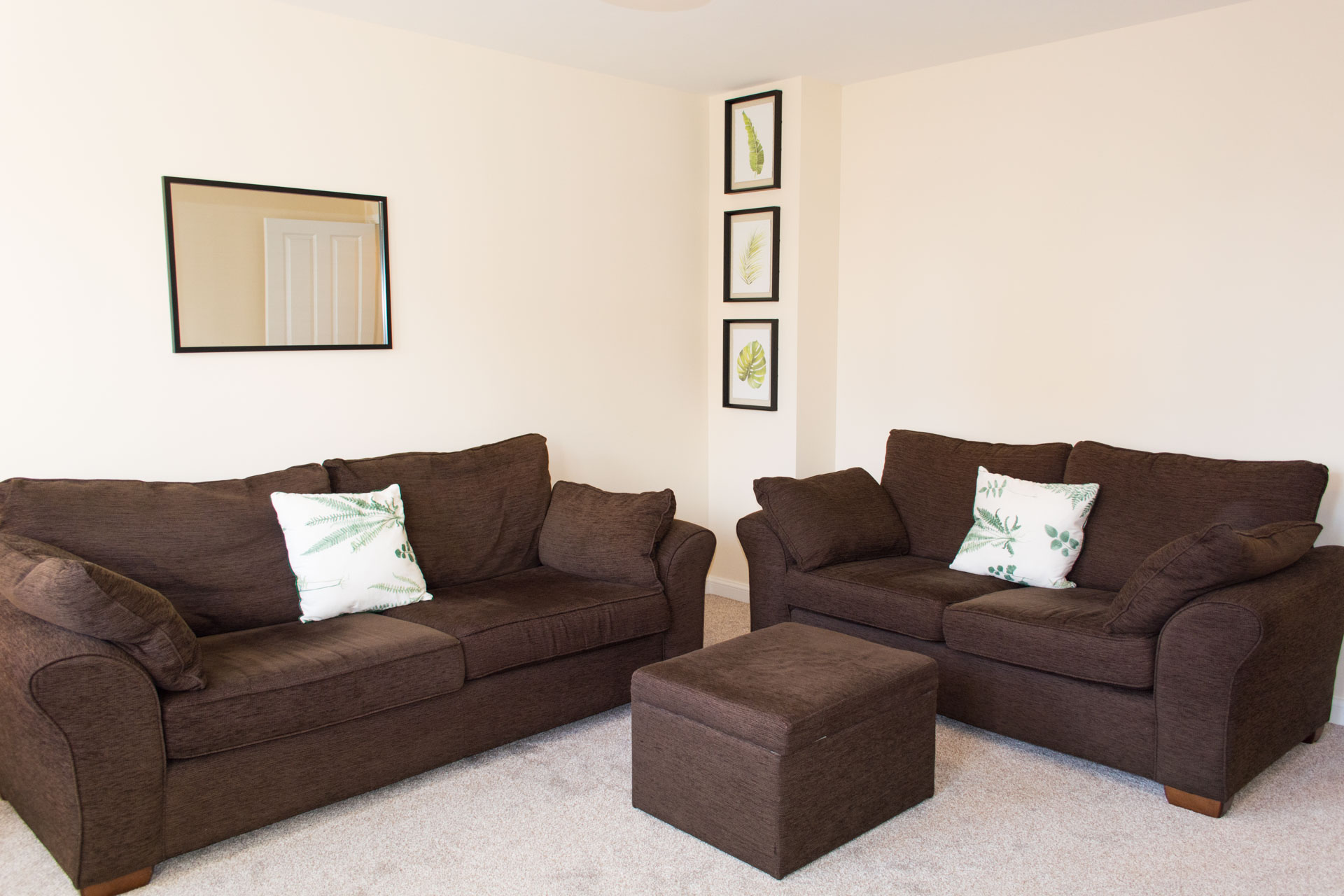 Two comfortable sofas and puffy.
