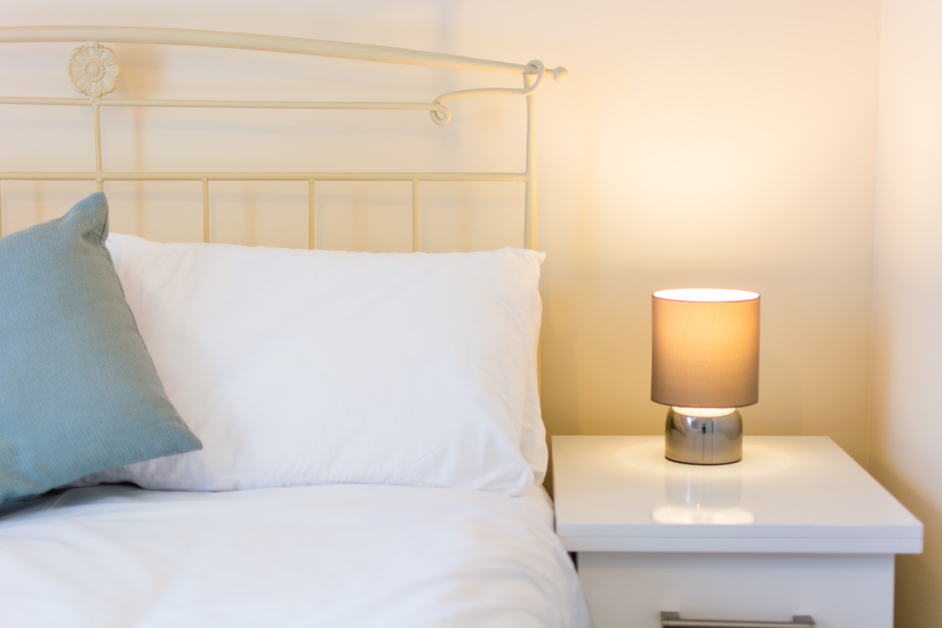 Bedside table with lamps.