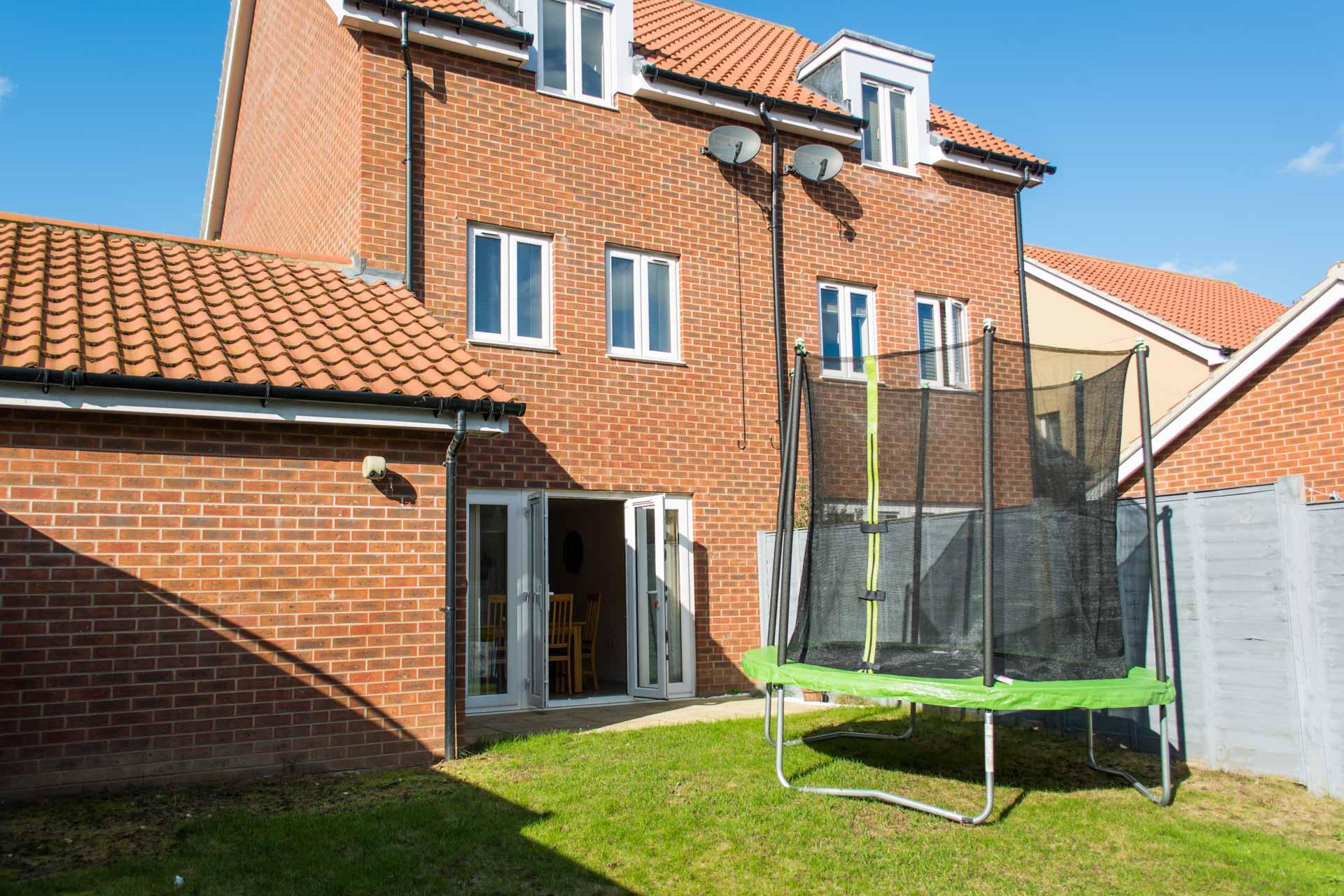 Norwich holiday rental garden with trampoline.