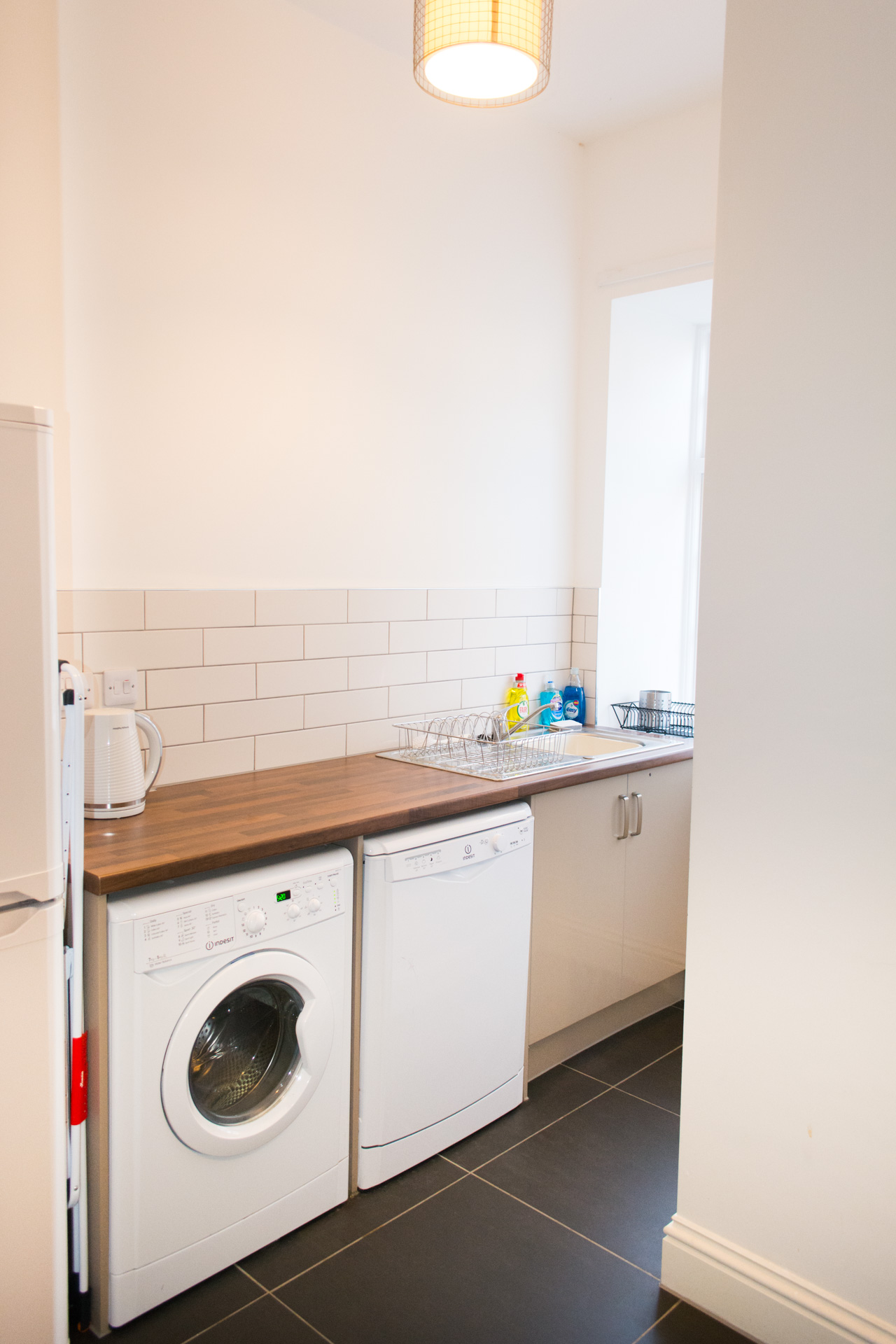 Wash room filled with amenities and white goods.