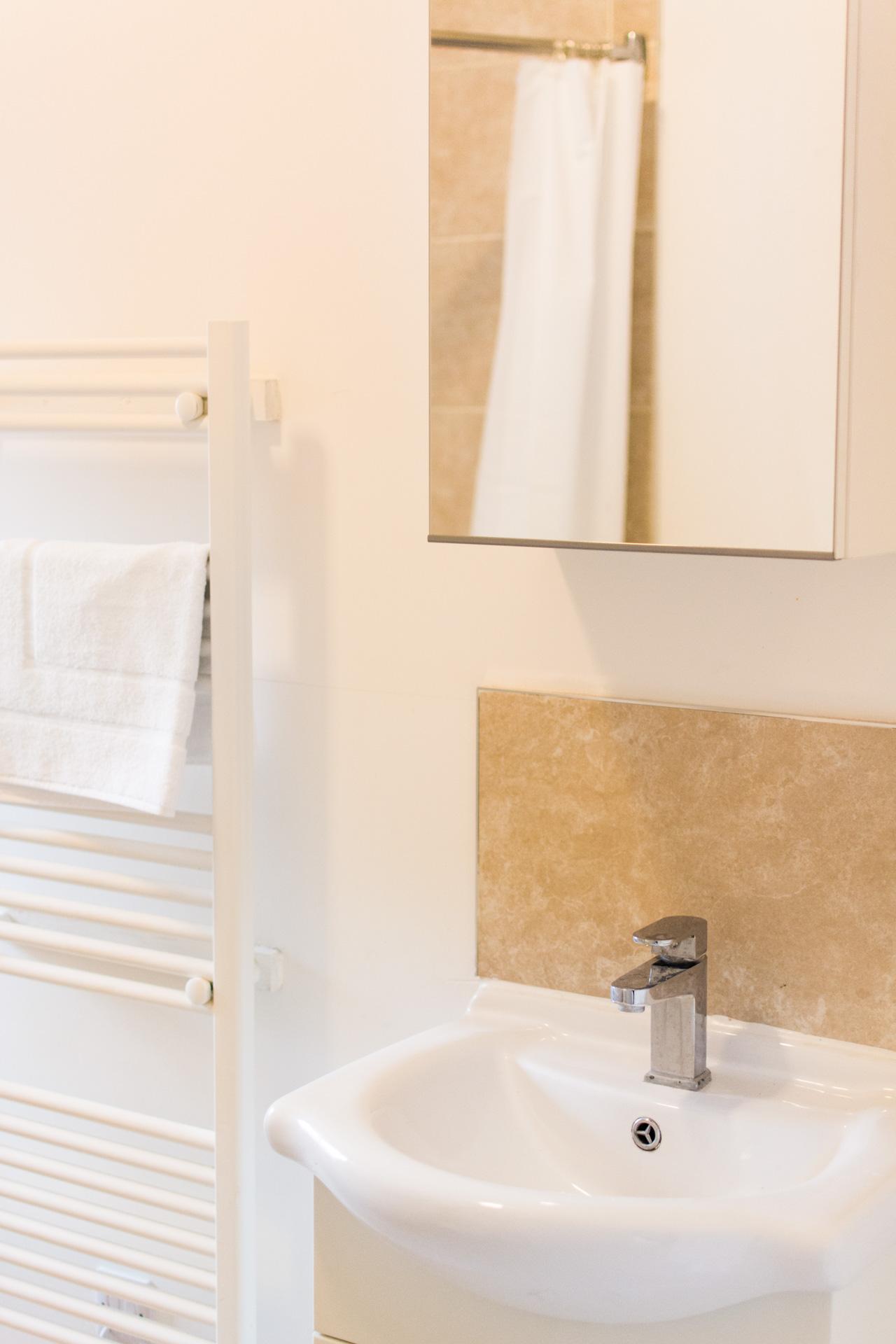 Towel rack and sink.
