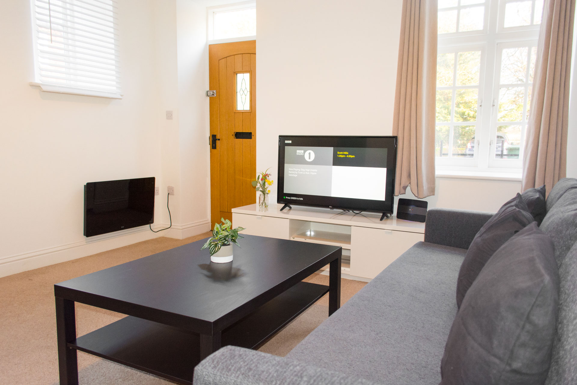 Grey sofas and black coffee table in family living area.