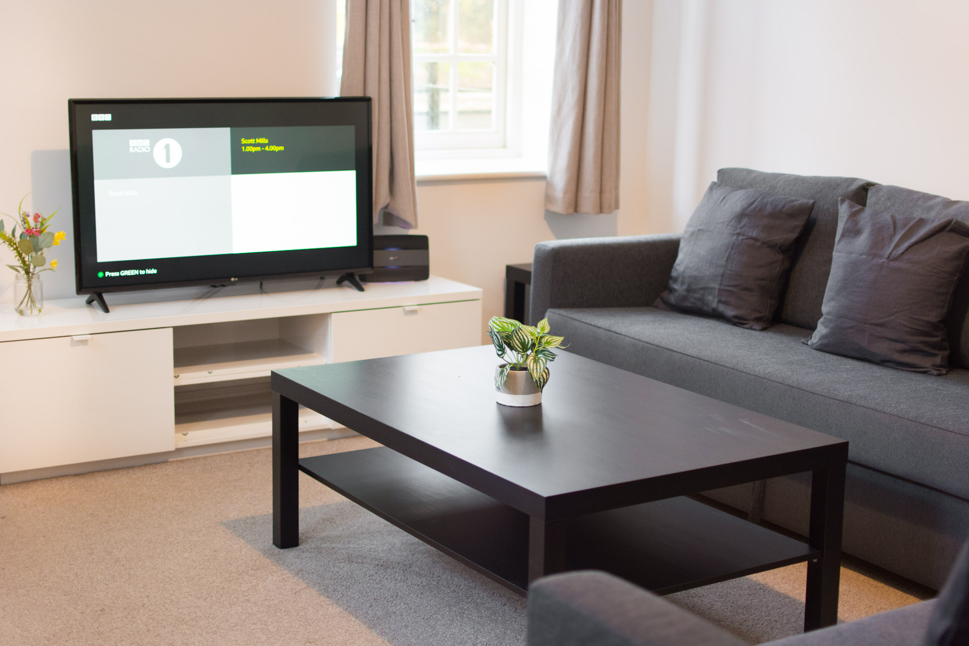 Coffee table and flat screen tv.