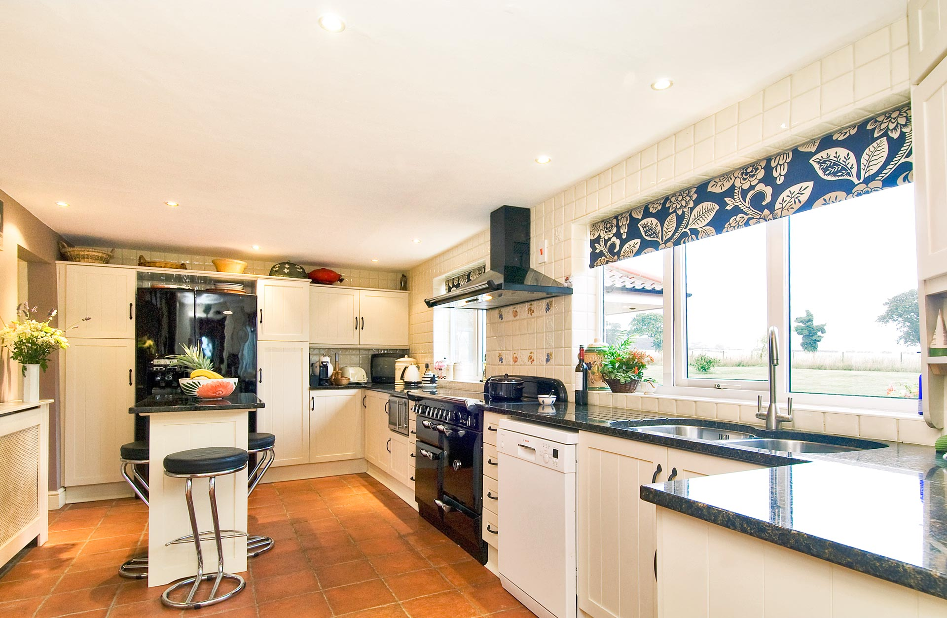 Holiday accommodation kitchen with island breakfast bar.