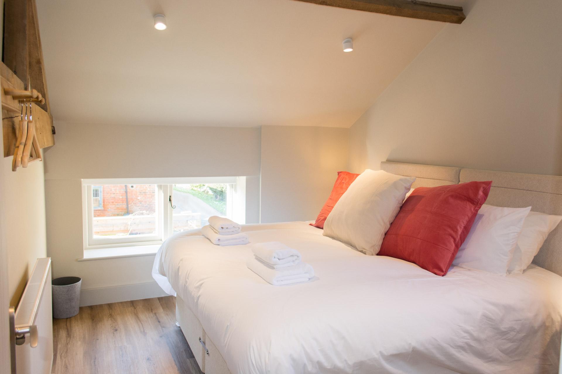 Super-king bedroom photo taken from the doorway