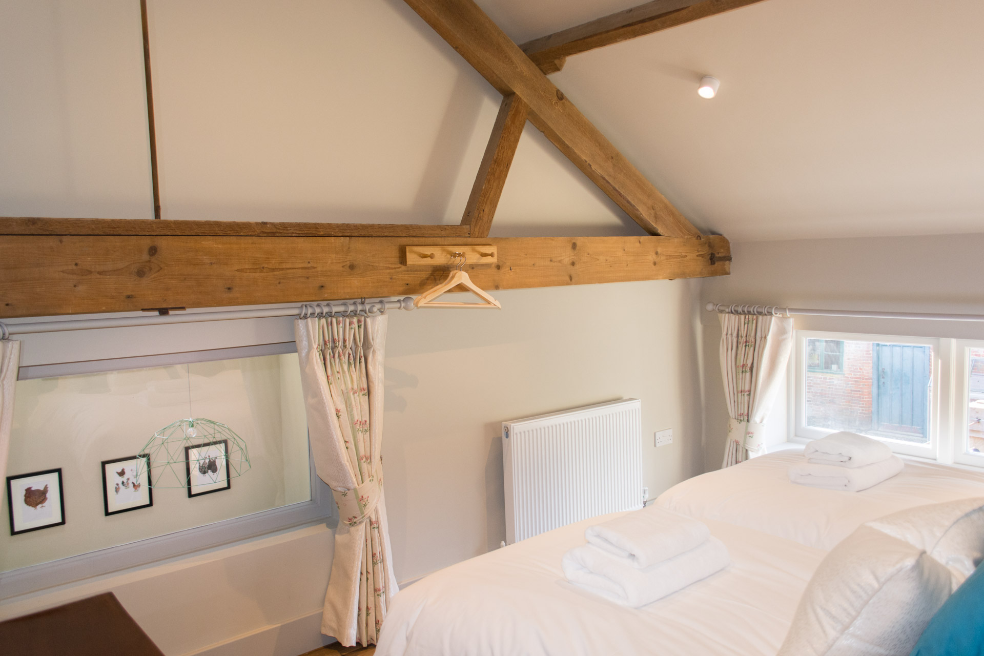 Window and wooden beams in the upstairs twin room of Boathouse Barn.