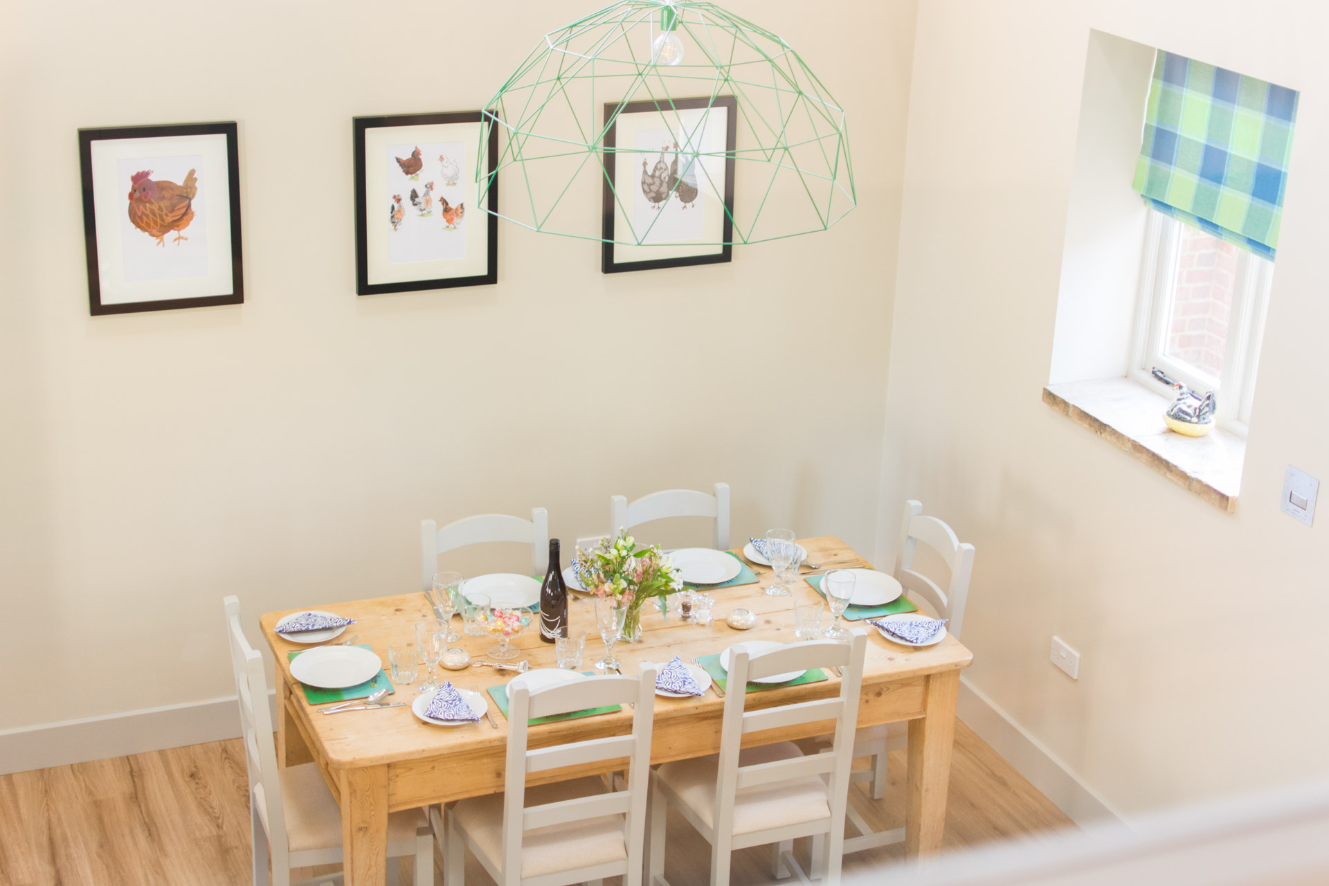 Dining area showing a laid table. Taken from the twin room upstairs bedroom.