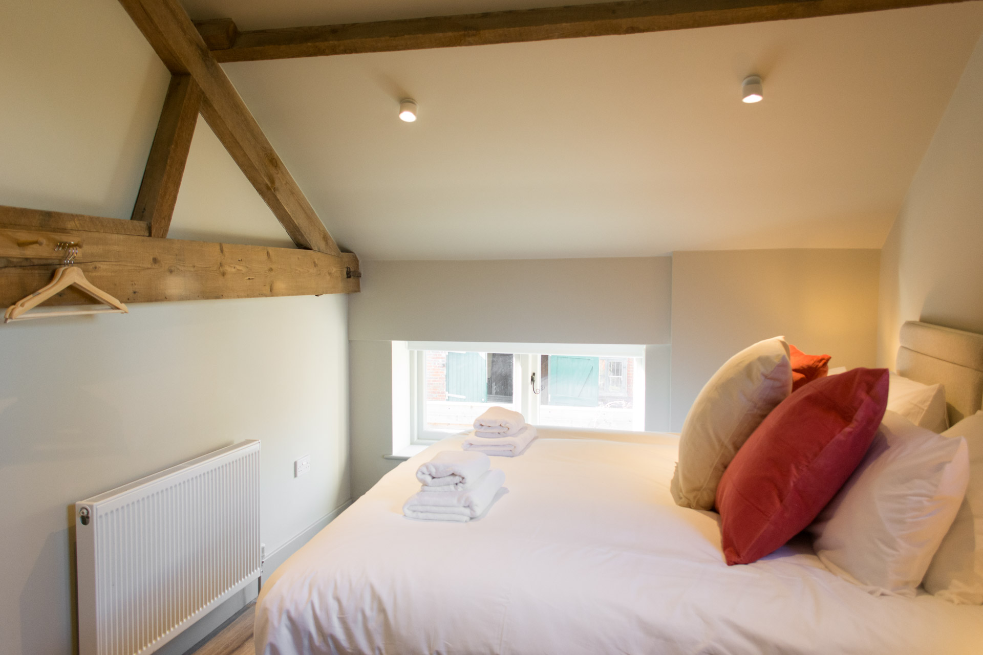 Super-king bedroom showing interior lights and window.