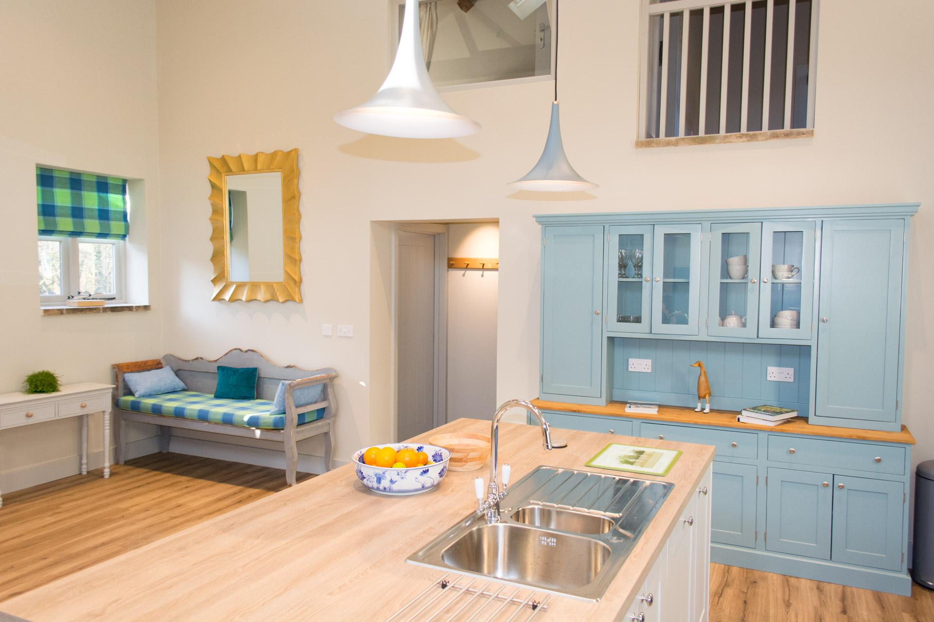 Holiday accommodation interior kitchen shot showing kitchen island and sink.