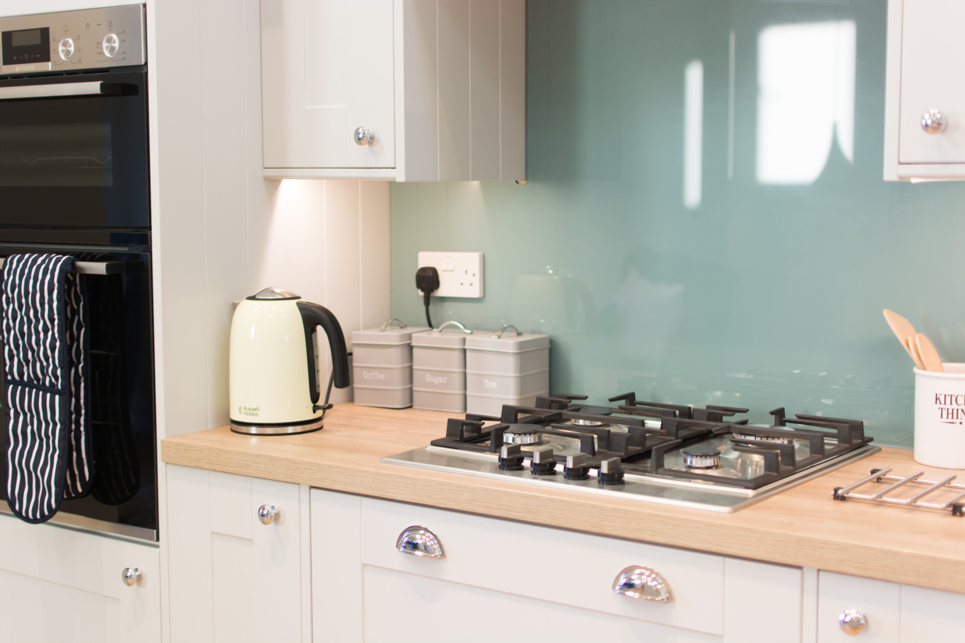 Kettle, toaster and stove top.