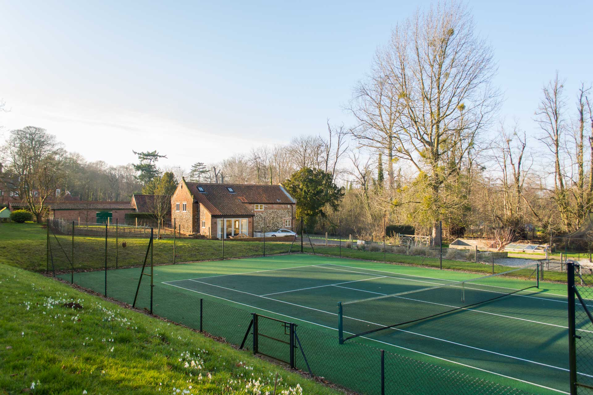 Tennis courts with Boathouse Barn in the background.