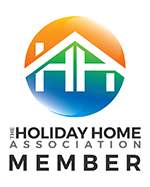 Holiday Home Association Members Badge showing orange, green and blue logo.