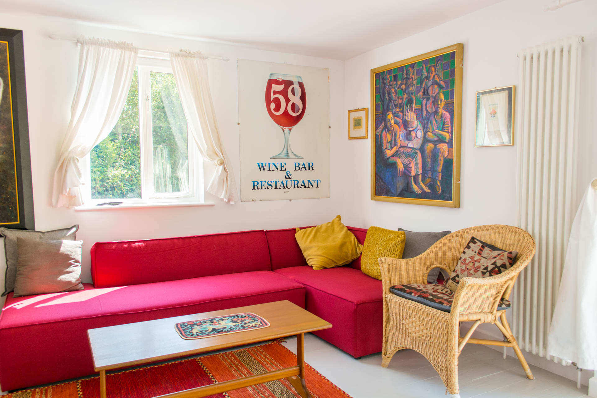 Image showing second family living area with red couch and artwork.