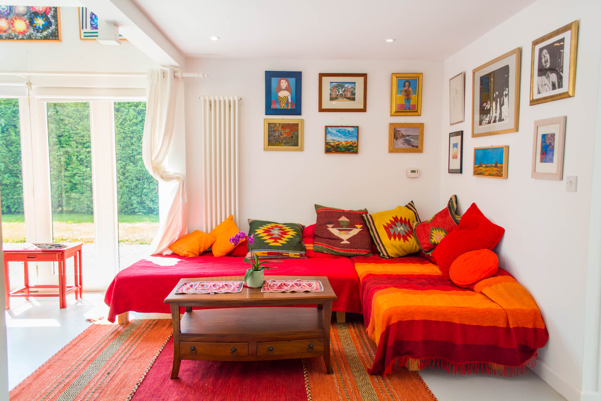 Holiday home living area showing red and orange themed living area.