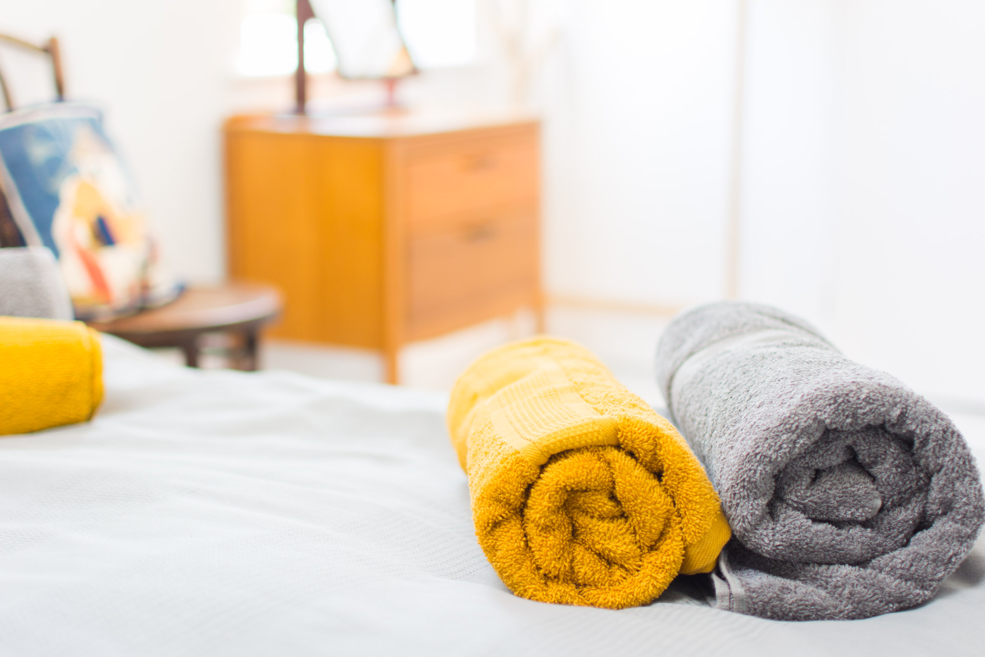 Close up photo of towels in the bed.
