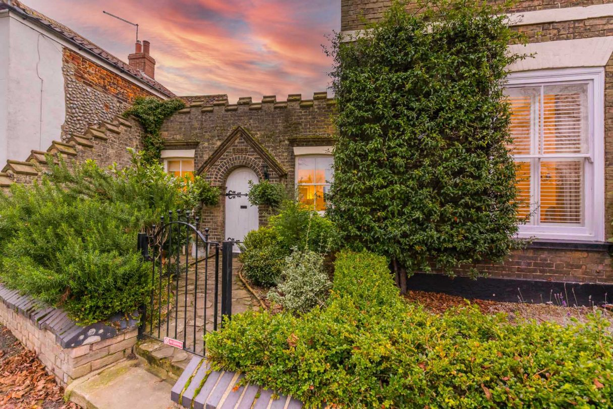 Outside view of Abbey House Cottage with a beautiful sunset.
