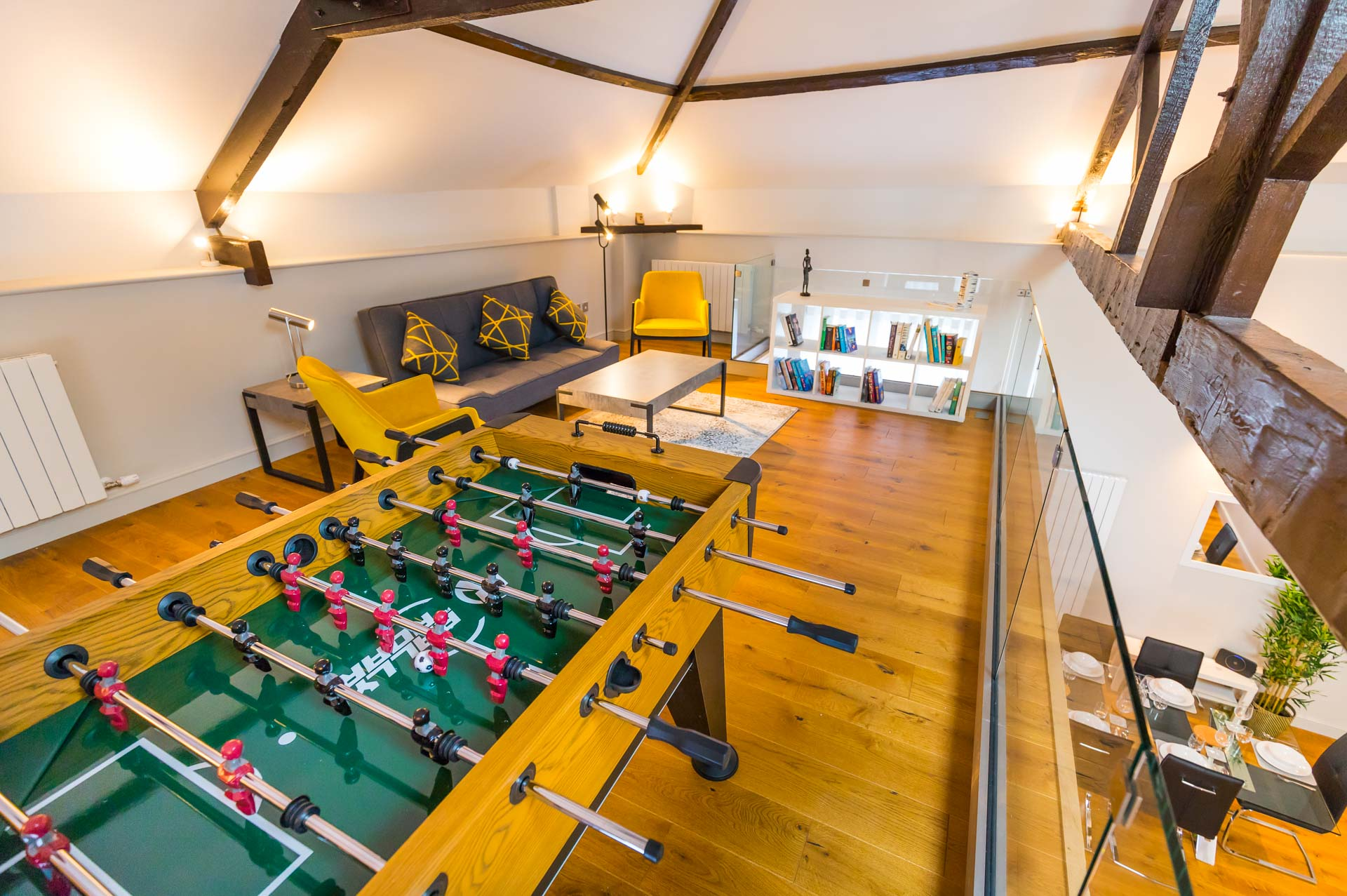 Upper mezzanine level with football table and living space.
